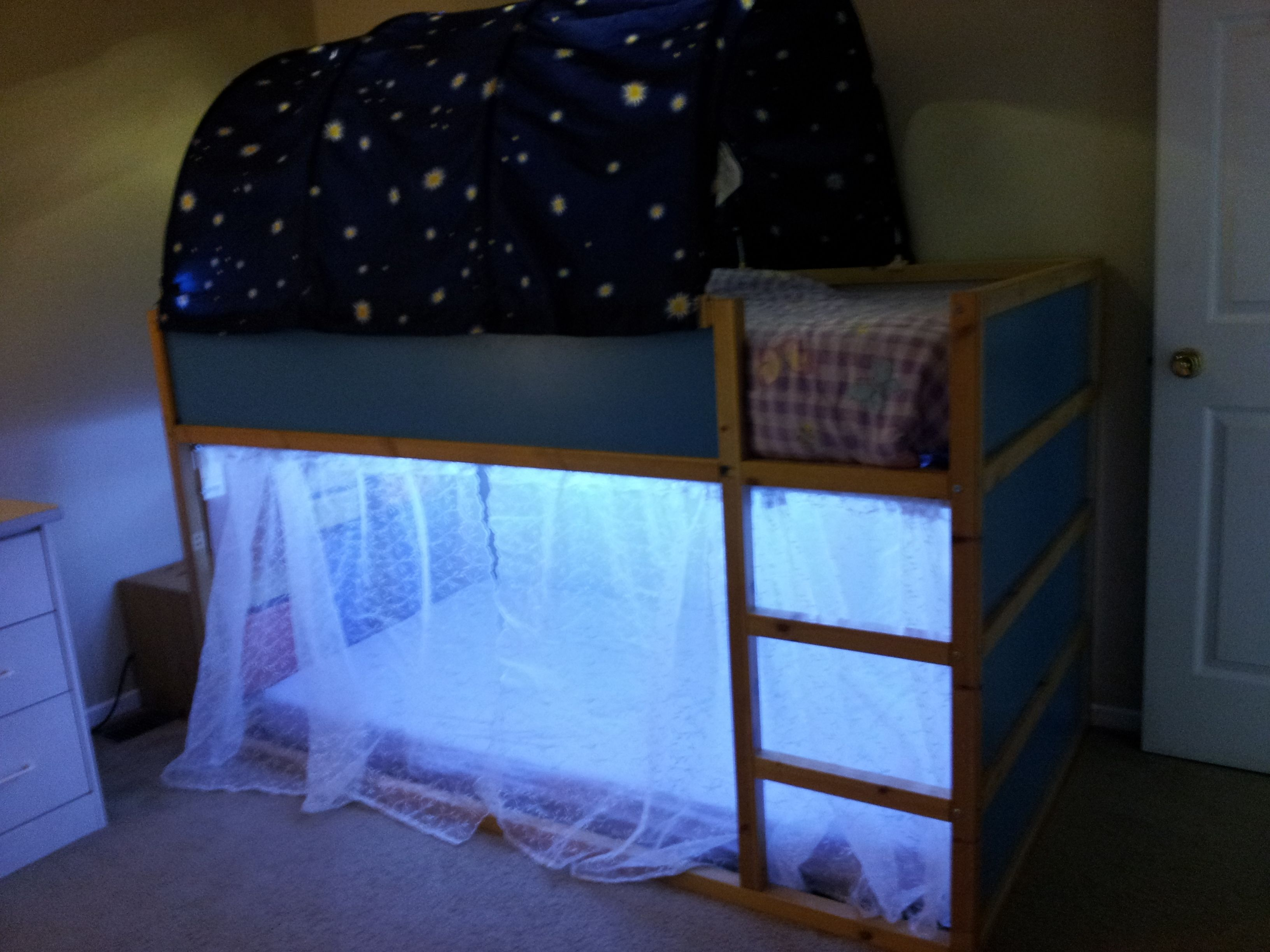 Loft bed curtain ideas  Kura bed with a Trofast unit for stairs added some curtains and LED