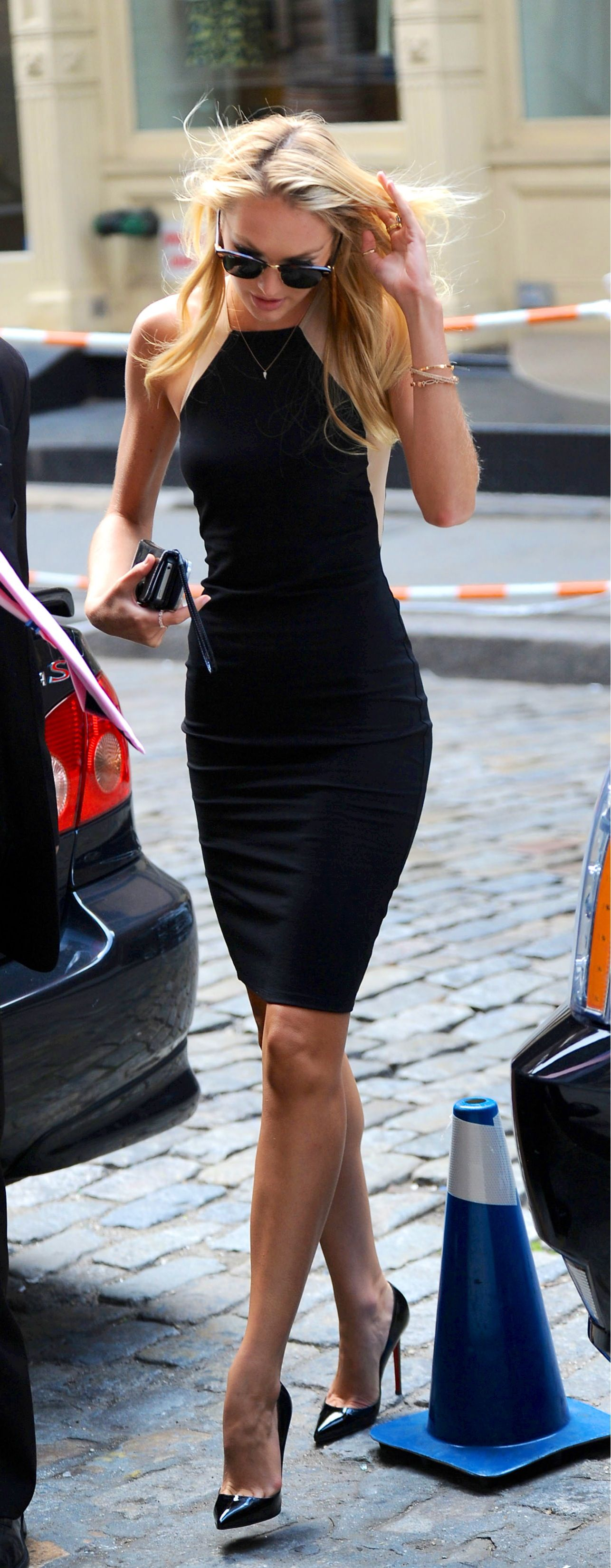 Street fashion...Candice Swanepoel, effortless chic black contour dress.