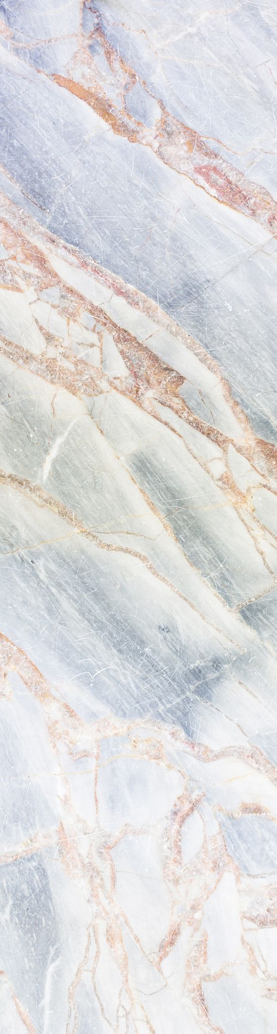 Get lost in the details with this decadent marble wallpaper design. Delicate blue texture is cut through with veins of bronze, making for a mesmerising wall mural. from muralswallpaper.com