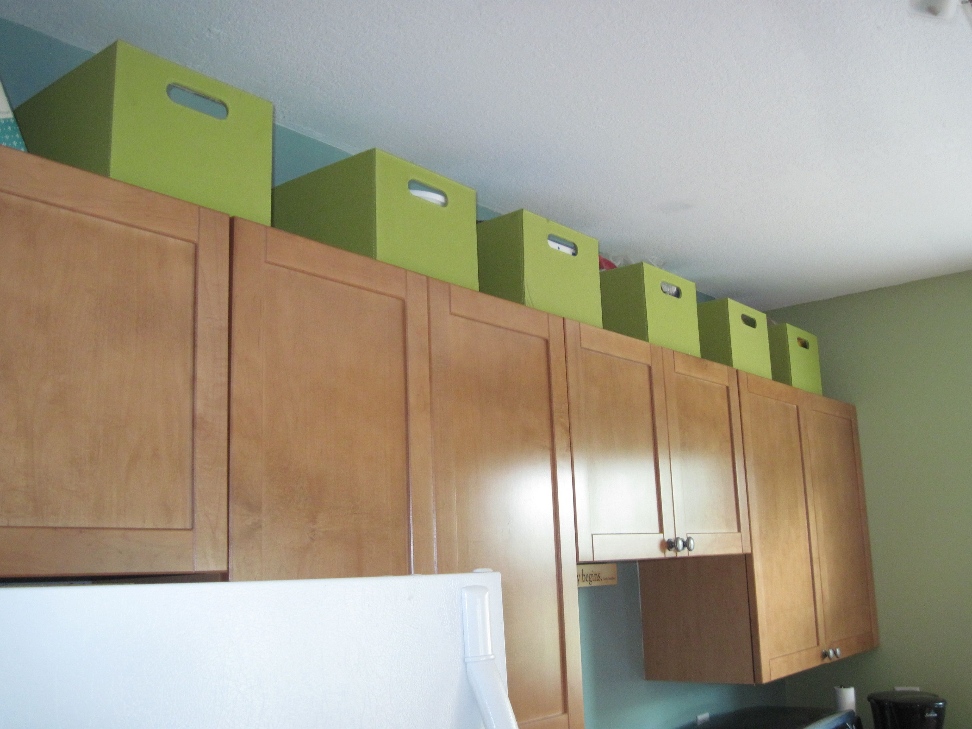 Use the space above kitchen cabinets for extra storage in a small space. Storage bins reduce visual clutter. : extra kitchen cabinets - hauntedcathouse.org