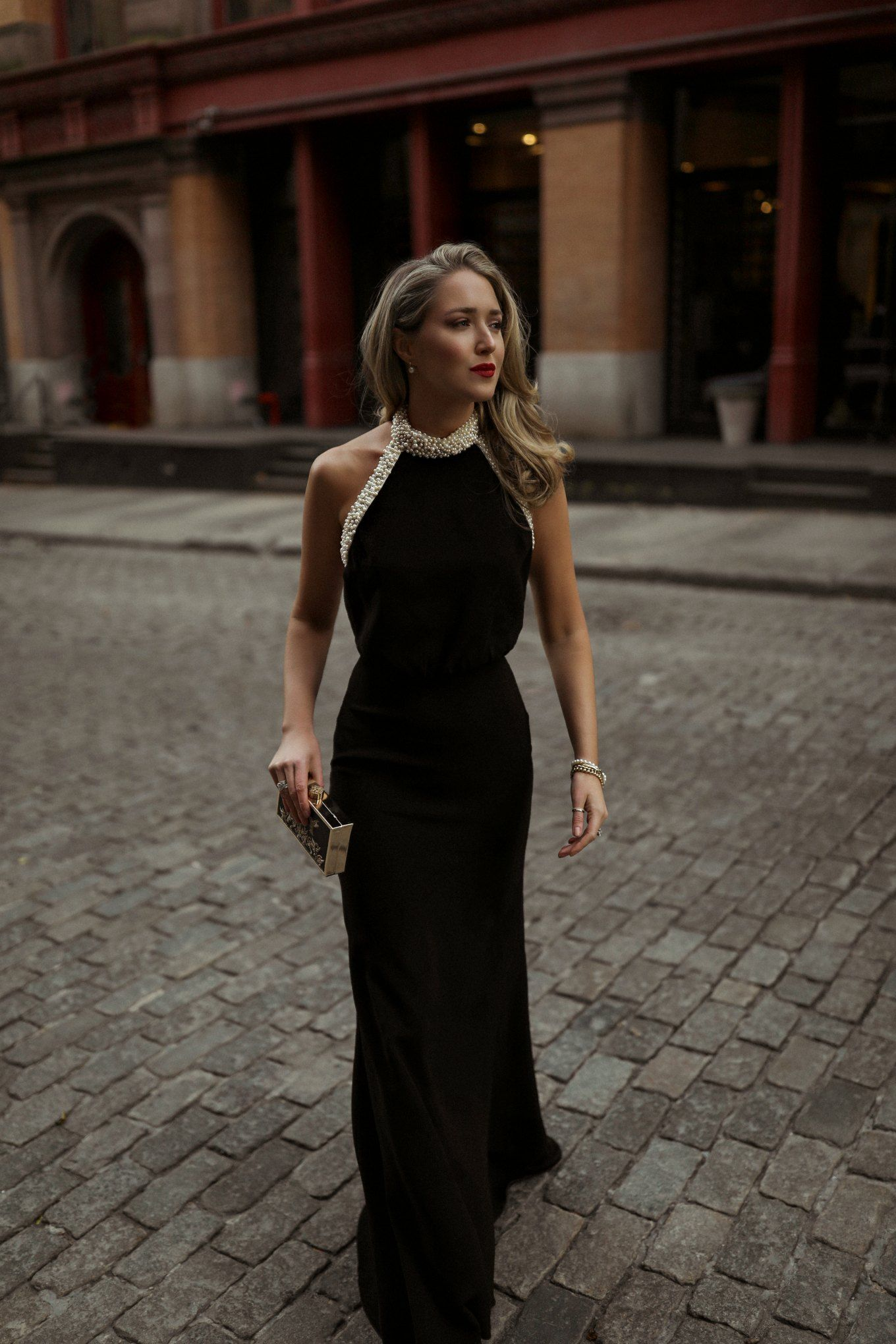 NYC style blogger wearing black evening gown