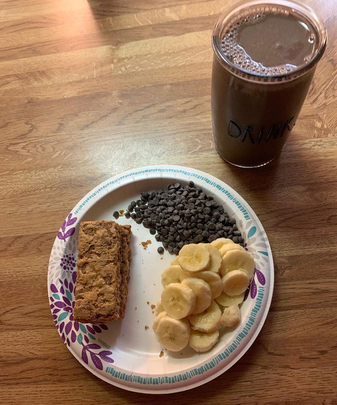 Mid morning snack... peanut butter granola bars with an organic banana, and chocolate chips. @silk dark chocolate almond milk on the side.
