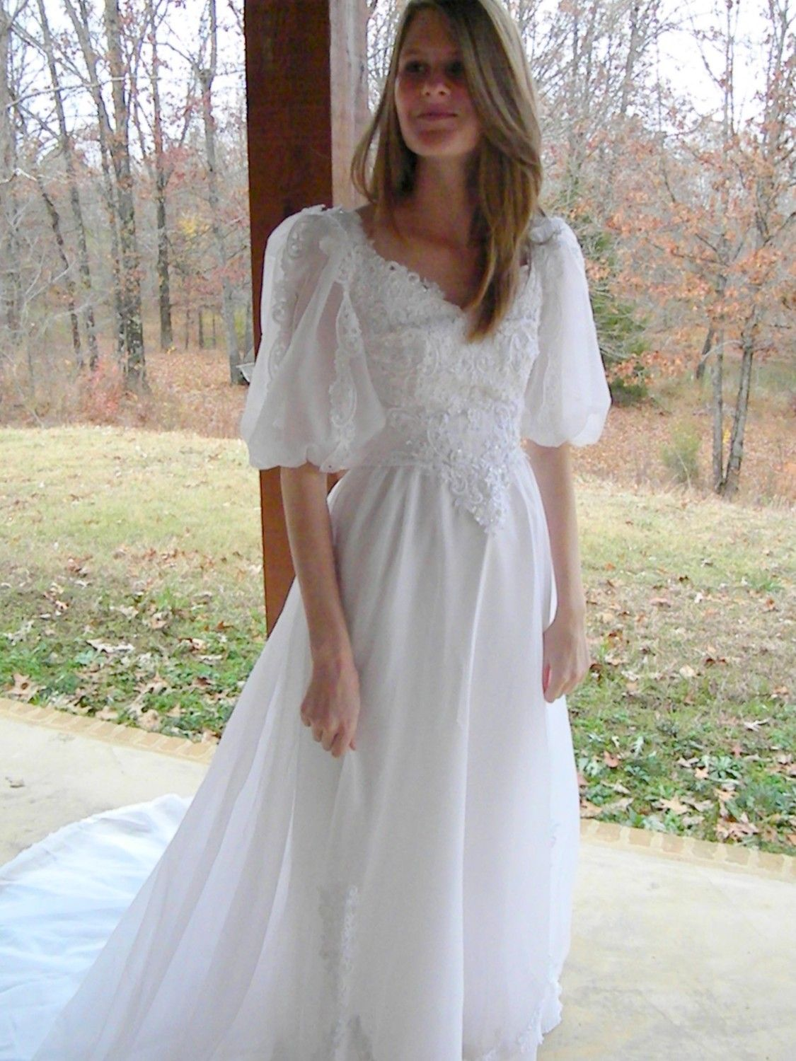 1980s wedding dress with puffy sleeves. [more at pinterest