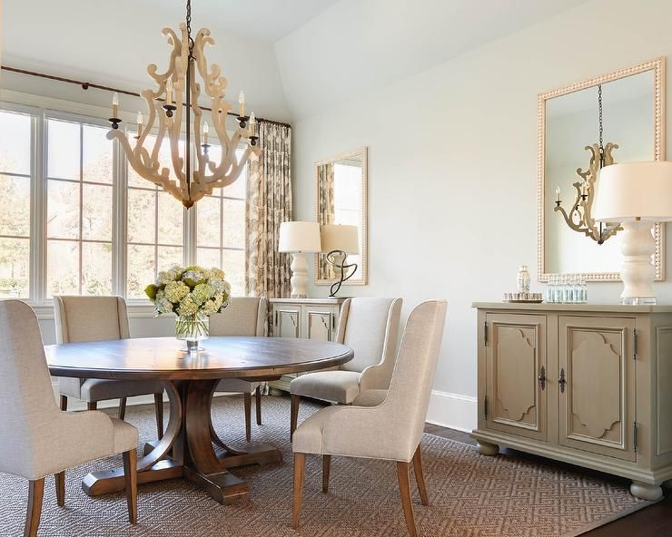 Taupe And Brown Dining Room Boasts A Carved Wood Chandelier Fascinating Jute Rug In Dining Room Design Decoration