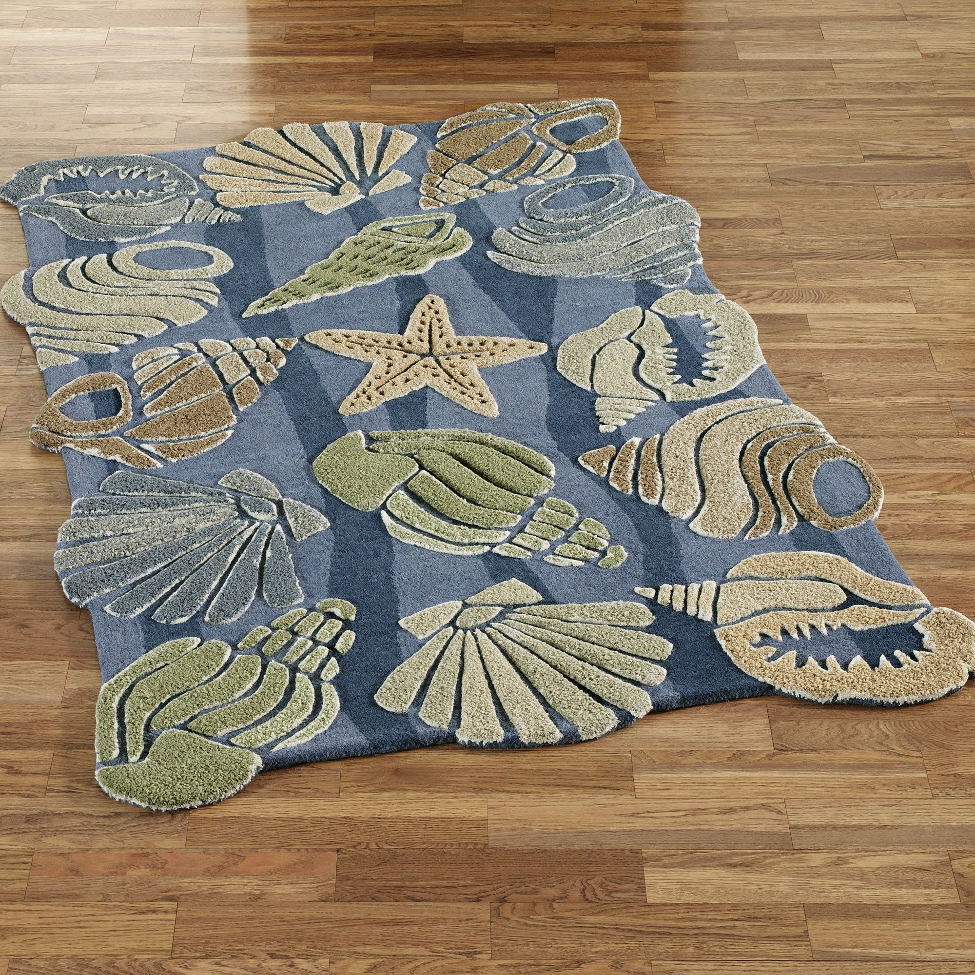 Complete The Theme In Your Cottage By The Sea With The Seashell - Blue and brown bath rugs for bathroom decorating ideas
