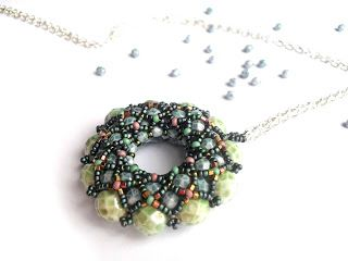#beadwork  Caliope's caprice: Conglomerate donuts pendant.