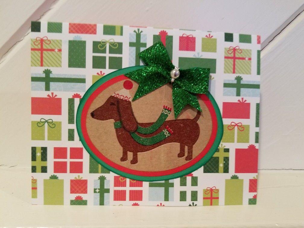 A preprinted Christmas card with a handmade embellishment. Daschund ...