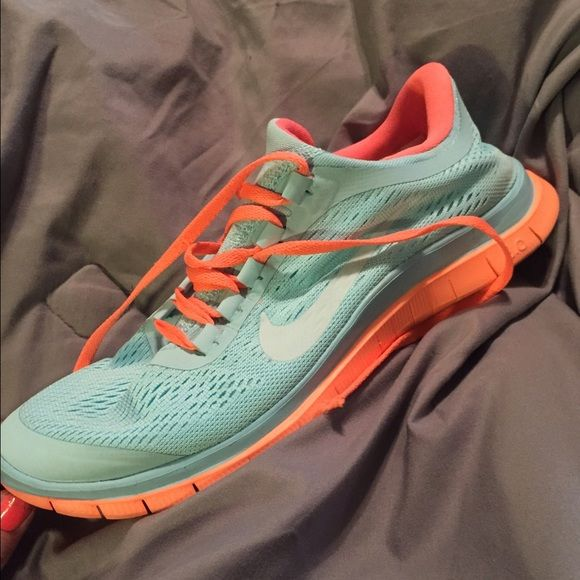 Nike Free 3.0 Tennis Shoes. Tiffany Blue & Neon Orange❤️ worn twice. Shoelace damage on one shoe (shown in picture) Nike Shoes Athletic Shoes