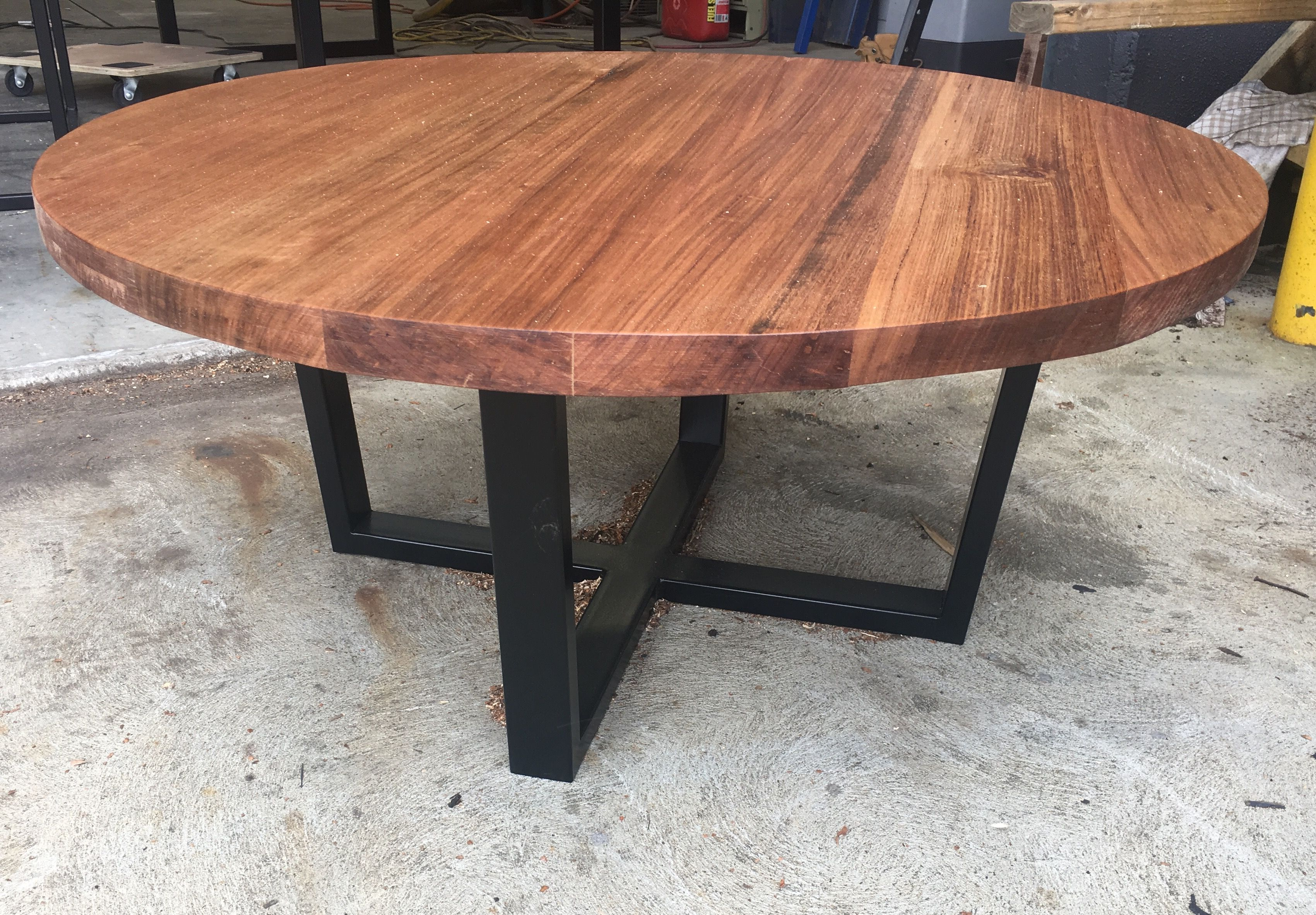 Recycled Tasmanian oak round coffee table with black metal legs ...