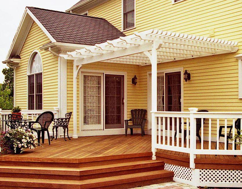 Pergola On Yellow House Deck With Pergola Pergola Patio Blocks