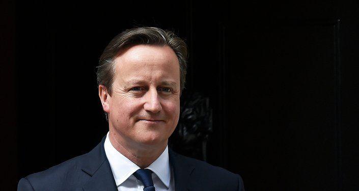 Britain's Prime Minister David Cameron waits to greet his Ukrainian counterpart Arseniy Yatsenyuk at Number 10 Downing Street in London, Britain July 15, 2015