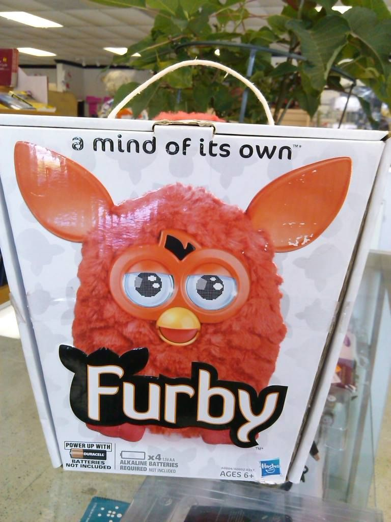 FURBY 2012 ORANGE/RED by Hasbro A Mind of its Own  Lots of ways to play with FURBY, Hold it, pet it, tilt it, shake it, turn it upside down, speak to it, and play music for it. Feed FURBY with your finger or from the free FURBY app. FURBY will interact with other FURBYs (each sold separately).   You shape its personality, Who your FURBY becomes might surprise you. Sold online for $60 and up, find it here for only $29.99!