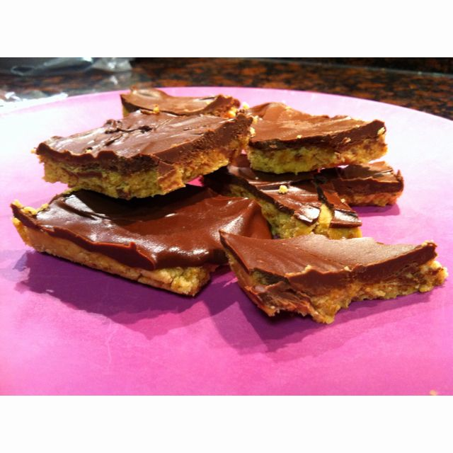 Easy No Bake Peanut Butter Bars  Yummy!  Super easy and a tasty treat. I used semi-sweet chocolate chips instead of milk chocolate.
