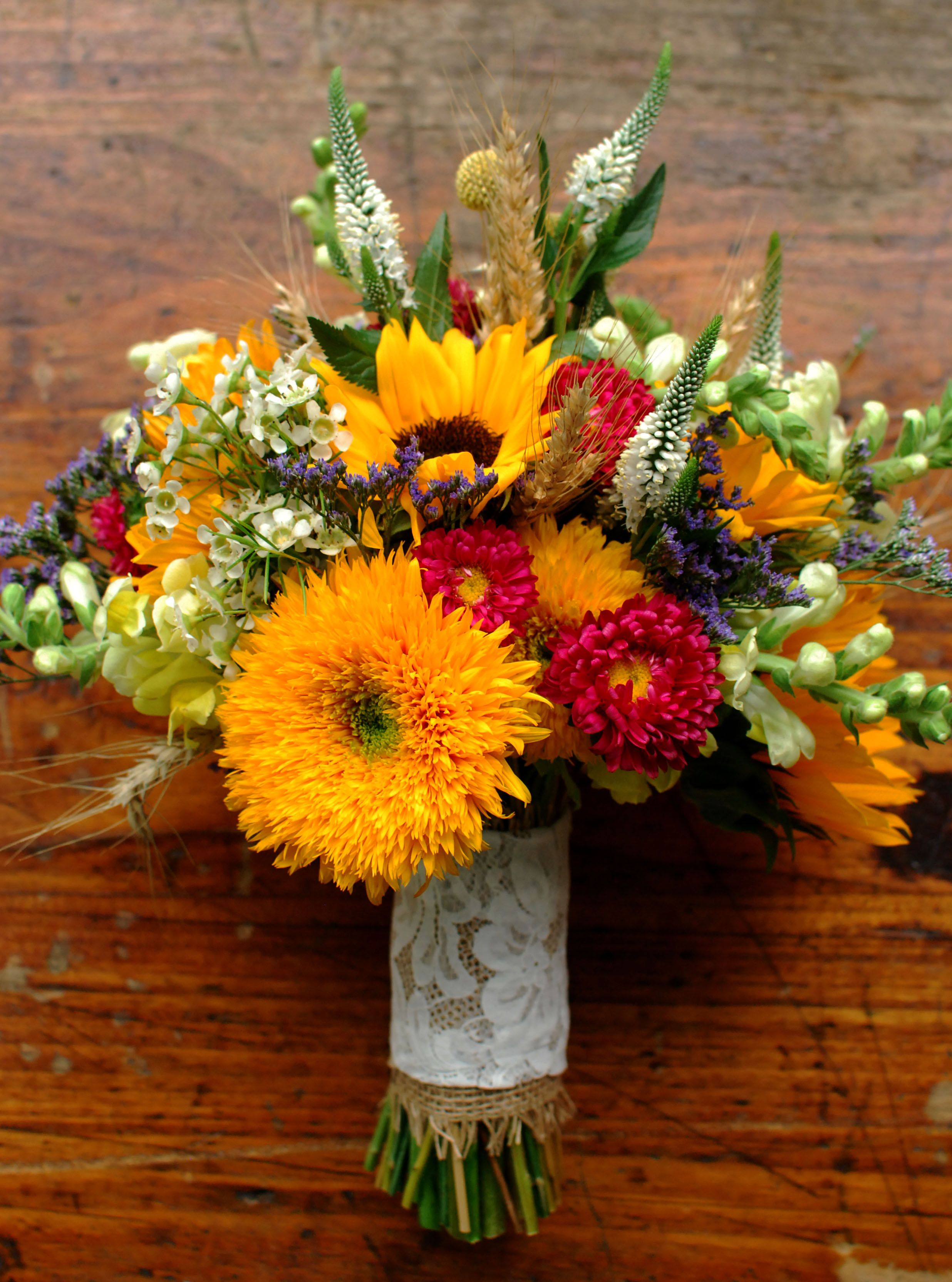 Early Autumn bridal bouquet, Sunflowers, aster, wheat, wax