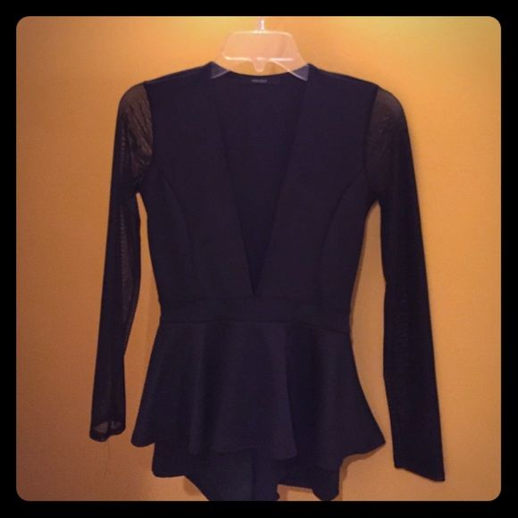 Black peplum romper only worn once! This peplum romper is solid black, with sheer long sleeves. Has a deep v down chest the gives just enough cleavage without popping out. The peplum area is super flattering on the waist leaving you with an attractive hour glass looking figure. shorts underneath that just cover the butt. I wear a size 4 to compare how this fits. Forever 21 Tops