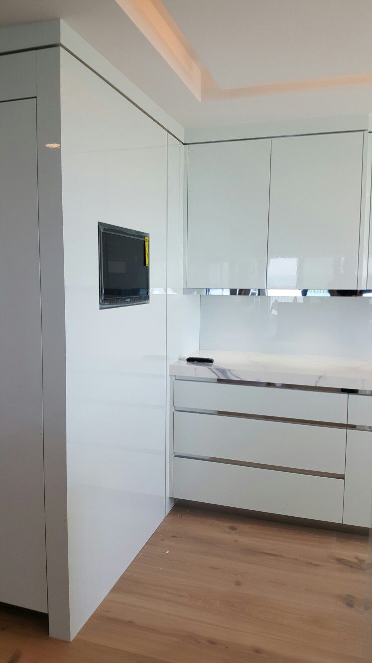 High gloss painted cabinetry with Chrome in all reveals. Naples ...