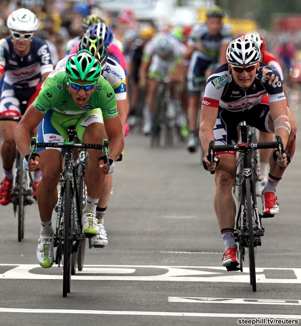 2012 tour-de-france photos stage-06.  Sagan ... just before beating Greipel to the finish line.  Notice the difference in expressions...and the torn jersey and road rash from crashing on Greipel.