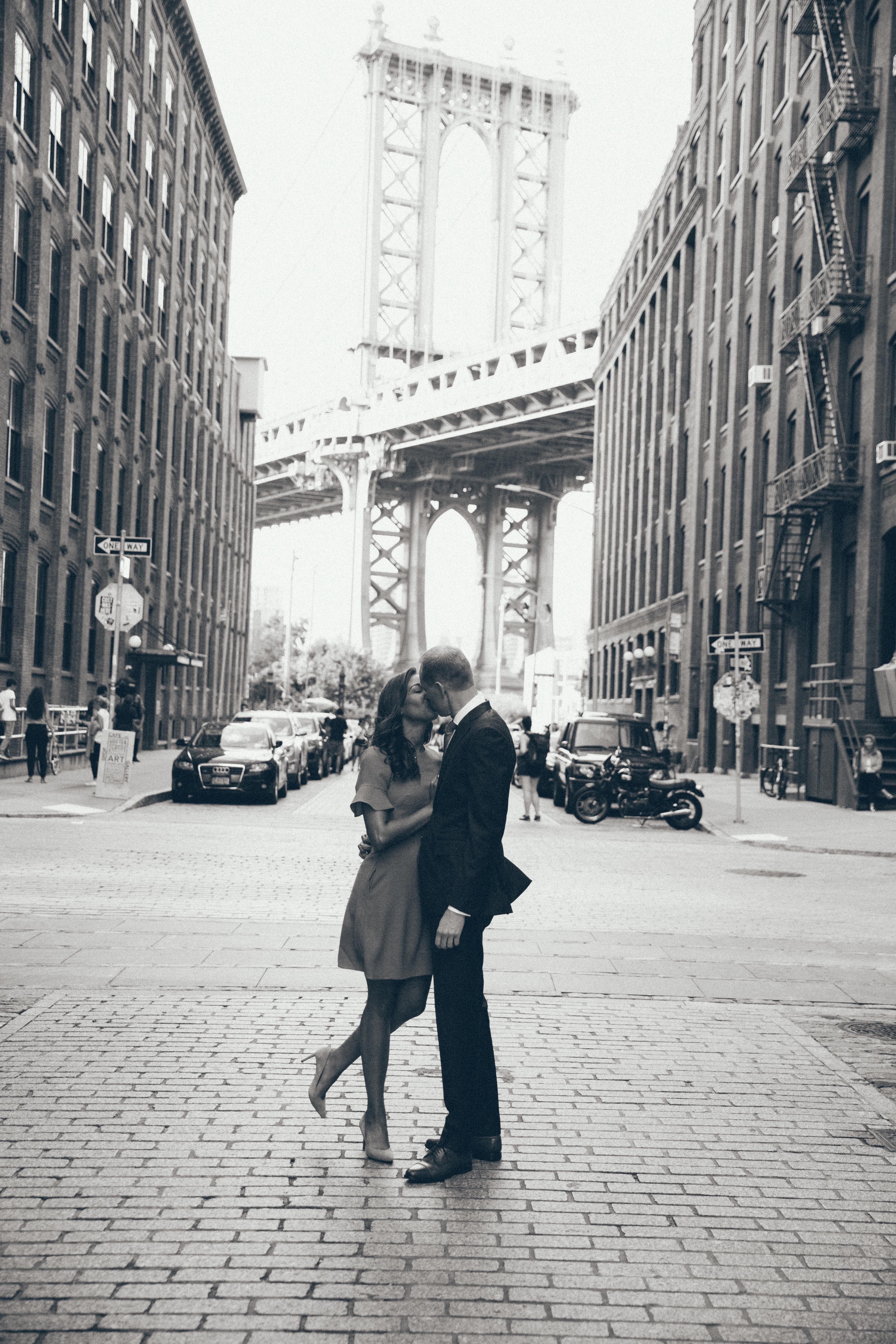 Romantic and classic black and white photography in iconic dumbo brooklyn for a dreamy engagement shoot with courtney webb and ryan spencer