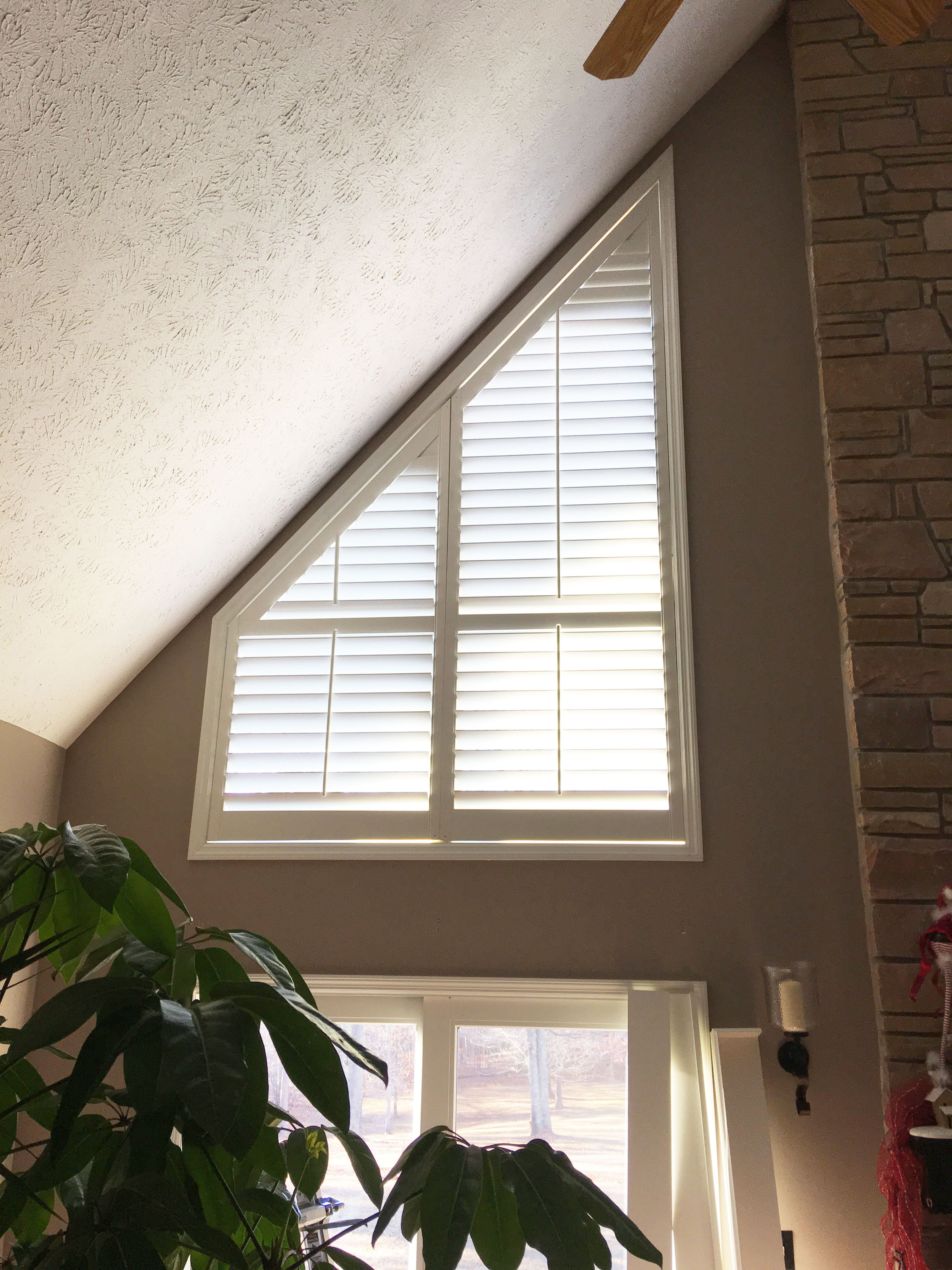 Slant top windows beautifully custom covered with our plantation