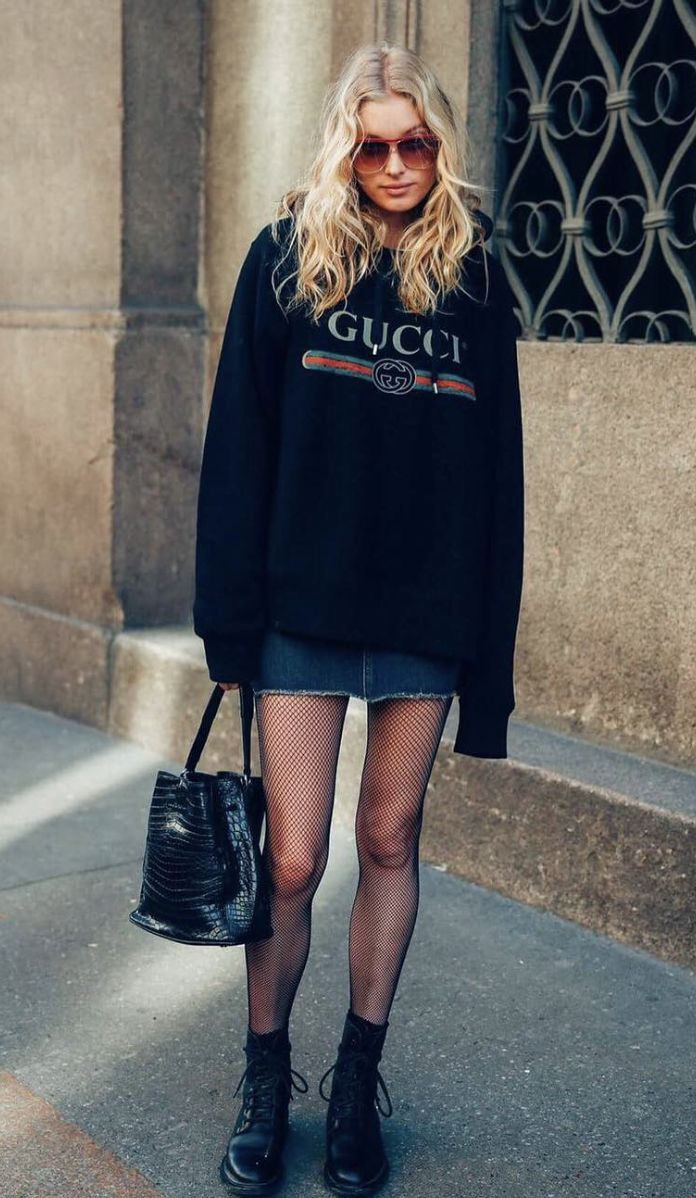 gucci outfits. oversized gucci hoodie, jean skirt, sheer tights, and black boots. outfits