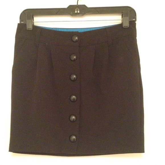 Black button down skirt Buttons and unbuttons. One pocket on each side. Perfect condition. No trades. No holds. Please send all offers through Poshmark's negotiation function, thanks! Skirts Mini