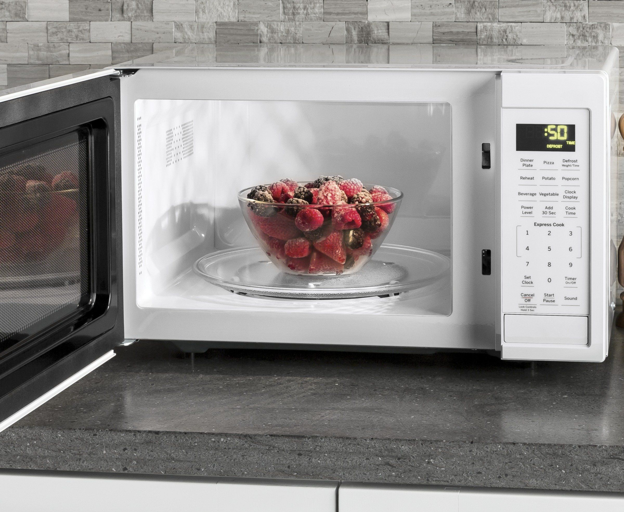 Ge 0 9 Cu Ft Capacity Countertop Microwave Oven White Continue
