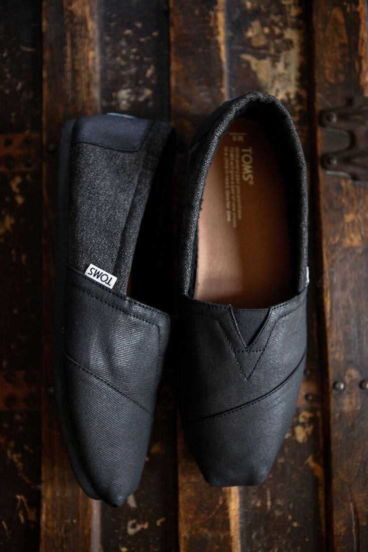 885d31d66b1 A warm take on a classic for men. Click to shop TOMS castlerock grey coated  canvas slip on shoes with faux shearling lining.