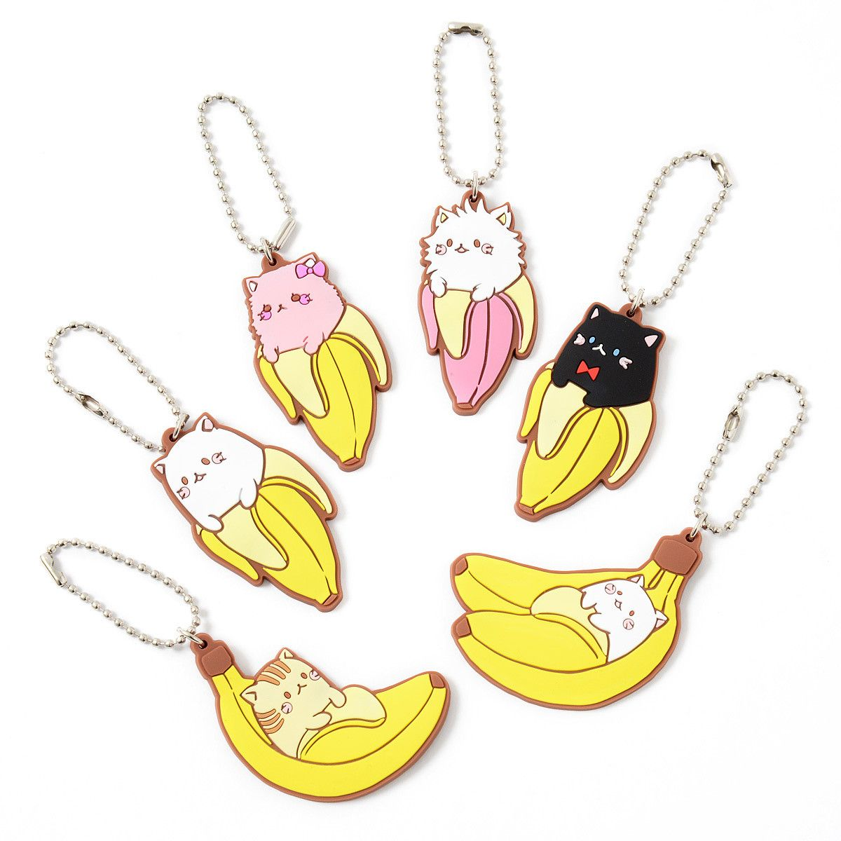"""These fun novelty **keychains** have a silly Japanese pun at their root which is sure to keep you laughing all day long! In Japan, cats go """"nya"""" so a Bananya is a banana with a cat inside - isn't that just so funny?   The full lineup includes **Bananya**, **Black Bananya**, **Kiddy Bananya**, **Fluffy Bananya**, **Bananya (Goron)** and **Tiger Bananya (Goron)** each of which is about **2.2""""** in size. You get **one random keychain** per order so you won't know exactly which flavor of…"""