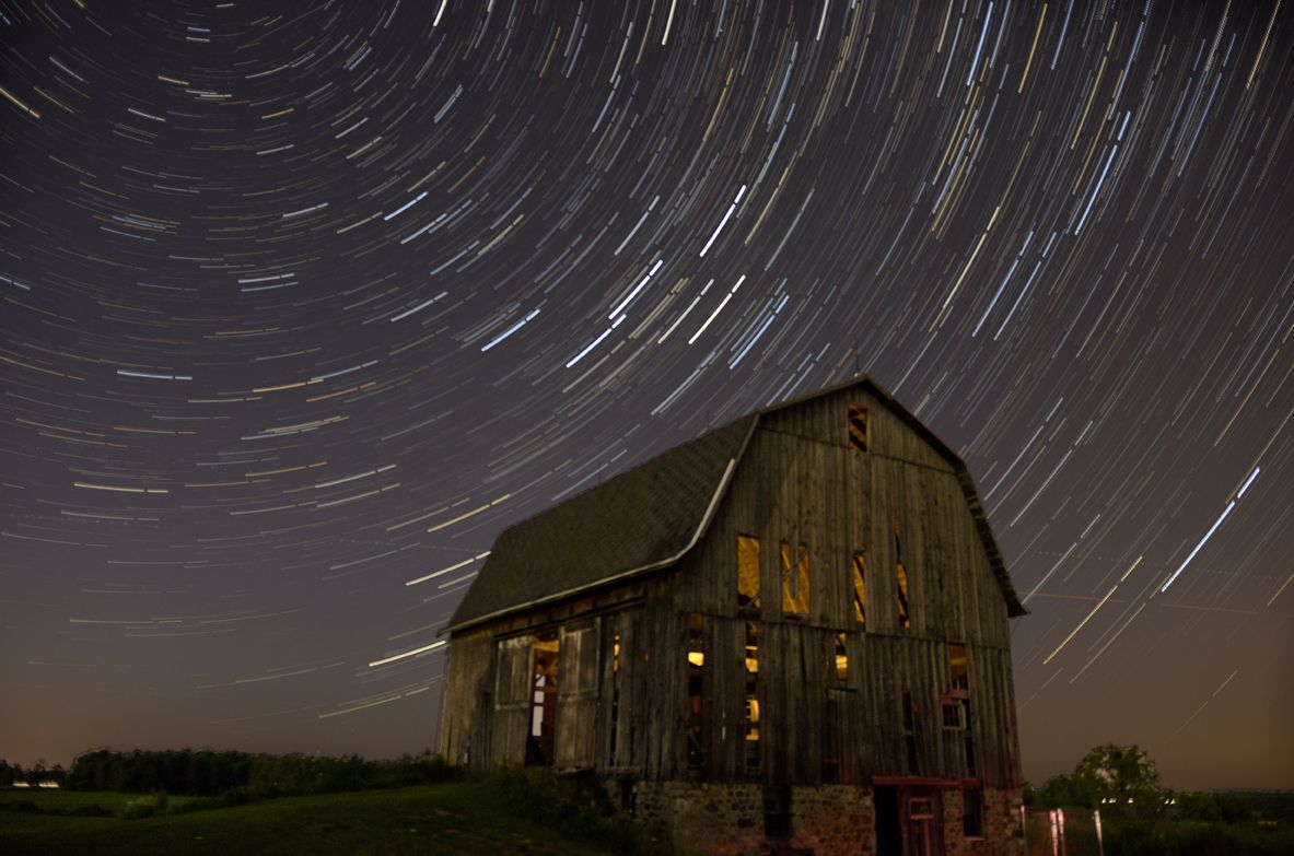 Rustic Barn With Star Trails. 52 Frame Stacked Photo