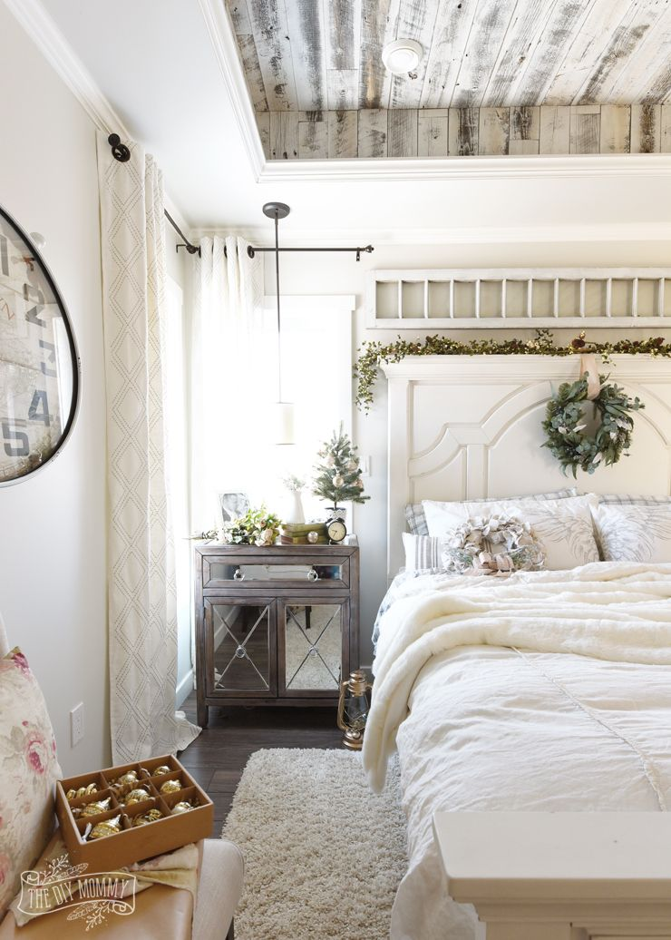french country farmhouse bedroom decorated for christmas holiday