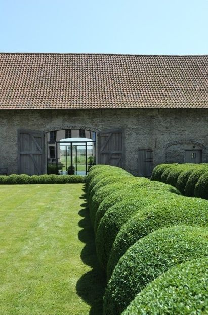 Large Topiary Boxwood Balls With Old Clay Tile And Stone Barn Huge Wooden Doorsfrom Modern Country Style Blog The Best Front Door Pai