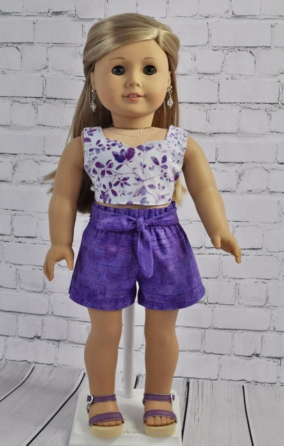 2 piece set. Floral crop top and purple shorts. Fits most 18 inch dolls such as American girl doll, #americandolls