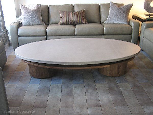 oval coffee table with a concrete table top. #concrete tables