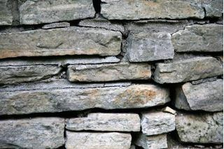 How To Make Fake Rocks Using Expandable Spray Foam Ehow Faux Stone Walls Faux Rock Walls Foam Carving