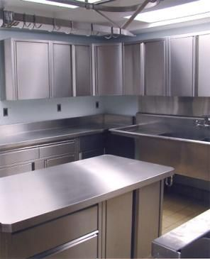 Stainless steel cabinets give a clean restaurant kitchen ...