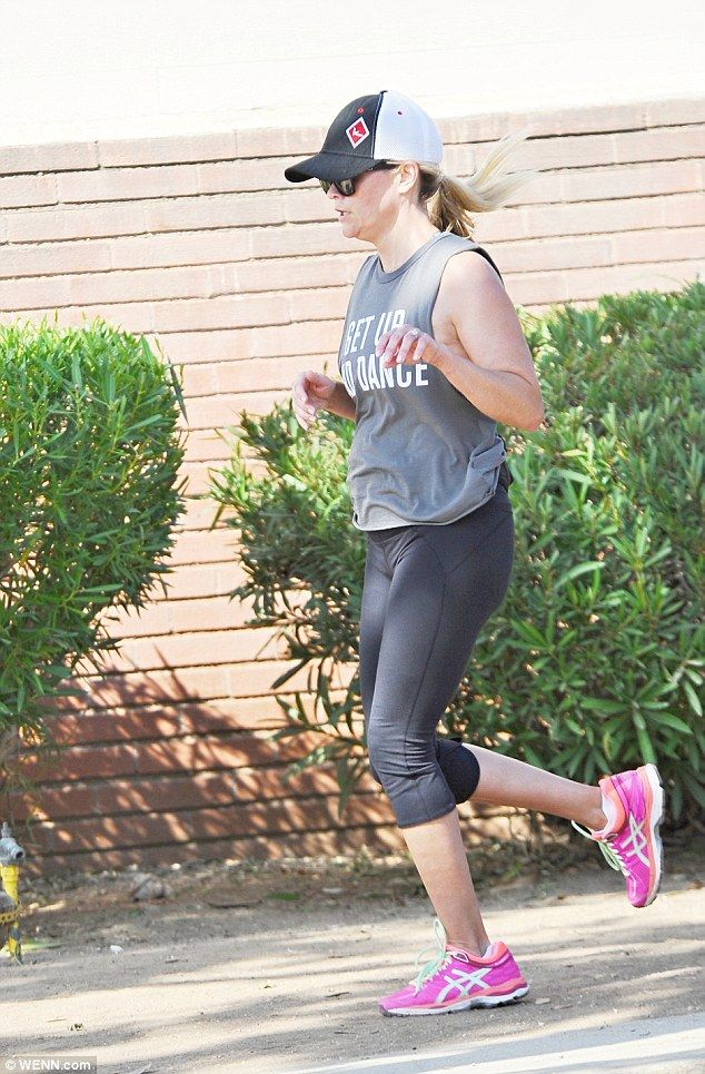 "Step out in pink like Reese in a pair of Asics sneakers  Click ""Visit"" to buy #DailyMail"