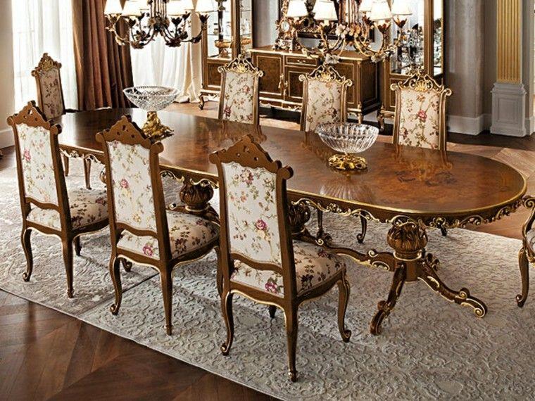 mesa larga de madera con forma ovalada muy elegante Sillas