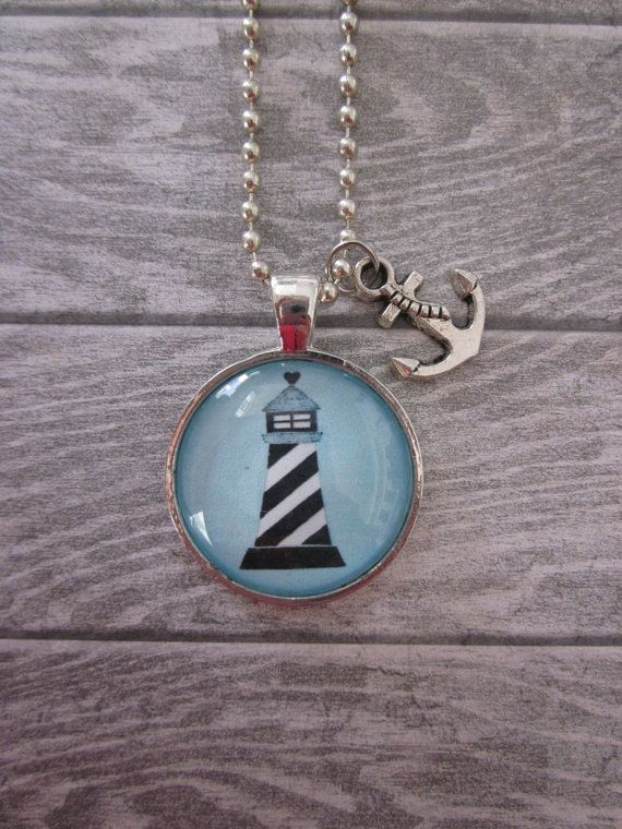 Blue Lighthouse Glass Pendant Necklace With Silver Anchor Charm. $14.99, via Etsy.