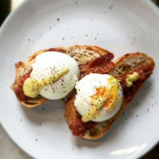 Poached eggs on sourdough toast and bacon