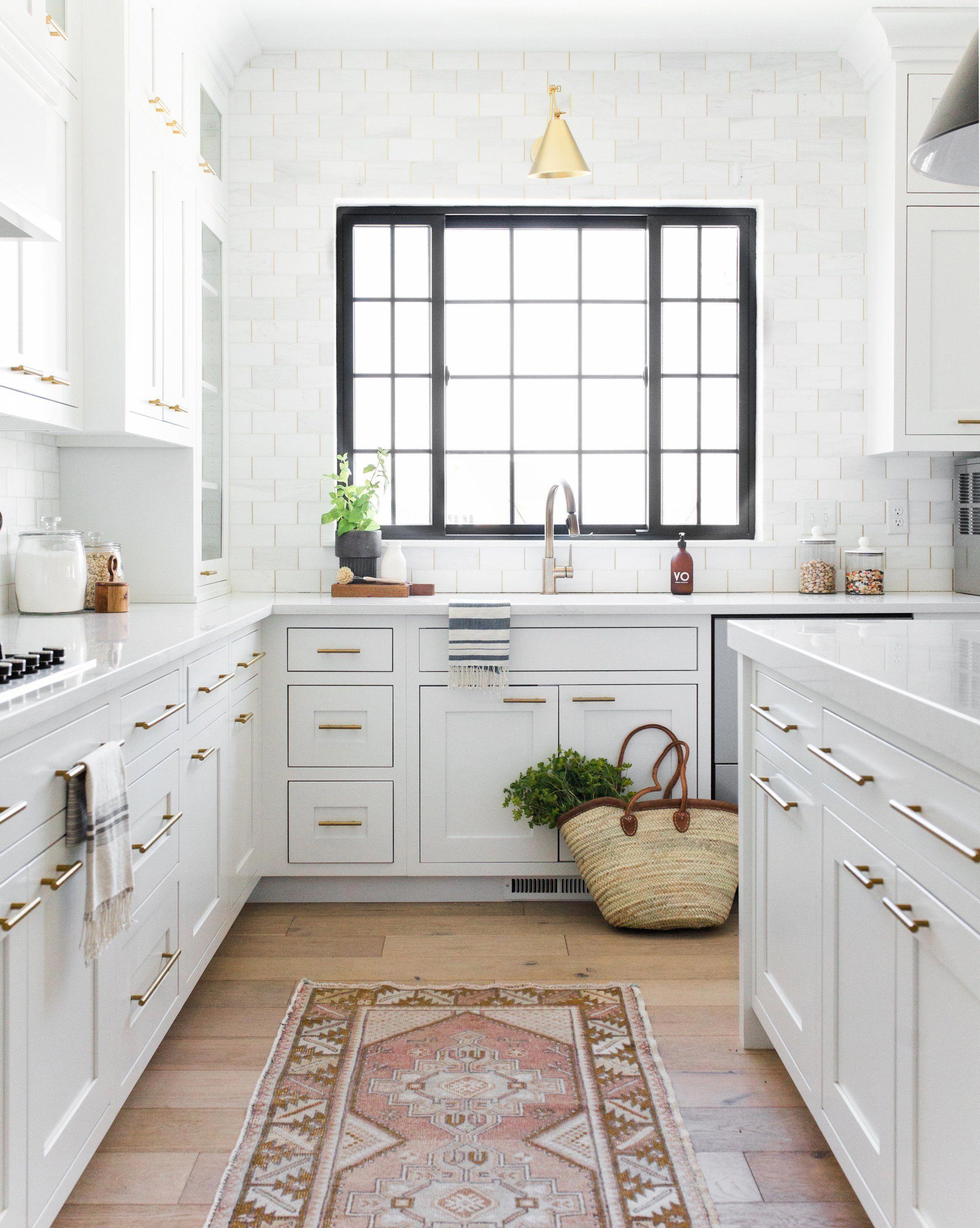 Like Black Window Trim White Subway Backsplash Door Pulls White Cabinets And Light Countertops H White Kitchen Design Modern Kitchen Design Kitchen Design