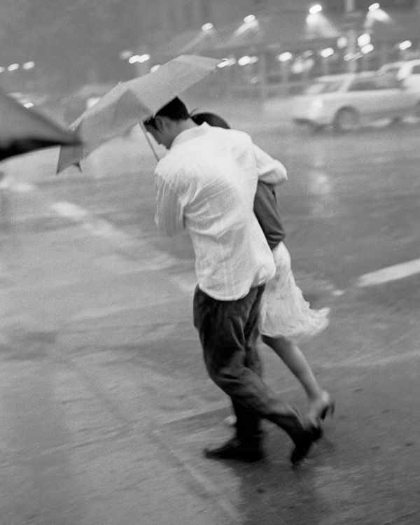 Couple in Rain  new york people; has that 50's feeling; maybe because it was shot with b film.  Shot in 2008.