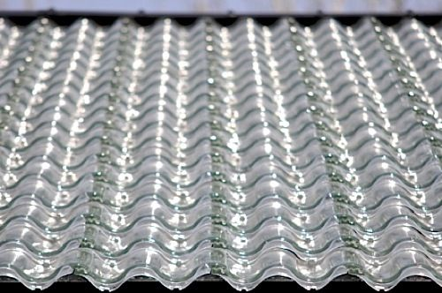 Glass Tile Roof Solar Heating Air Underneath The Glass Mounted On Black Insulation Is Heated By The Sun No Matter Wha Solar Panels Solar Roof Solar Energy