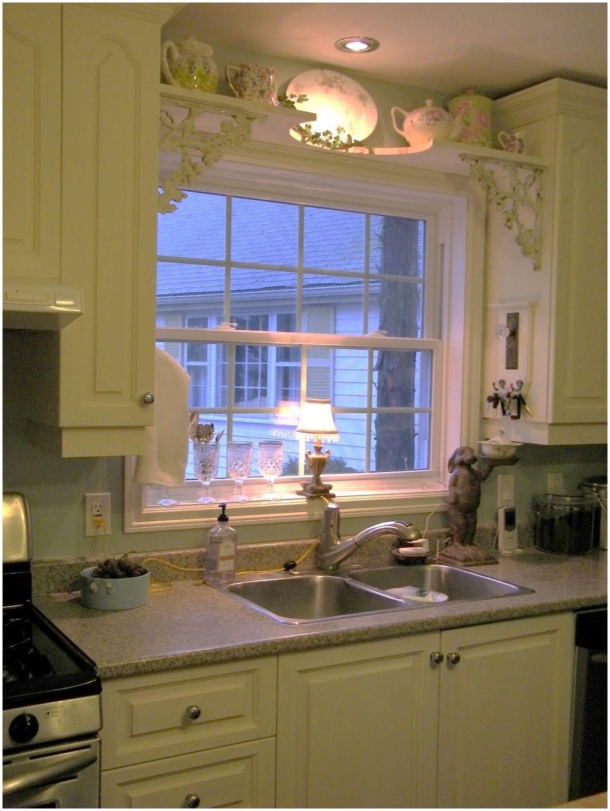Kitchen sink shelf over window with antique brackets