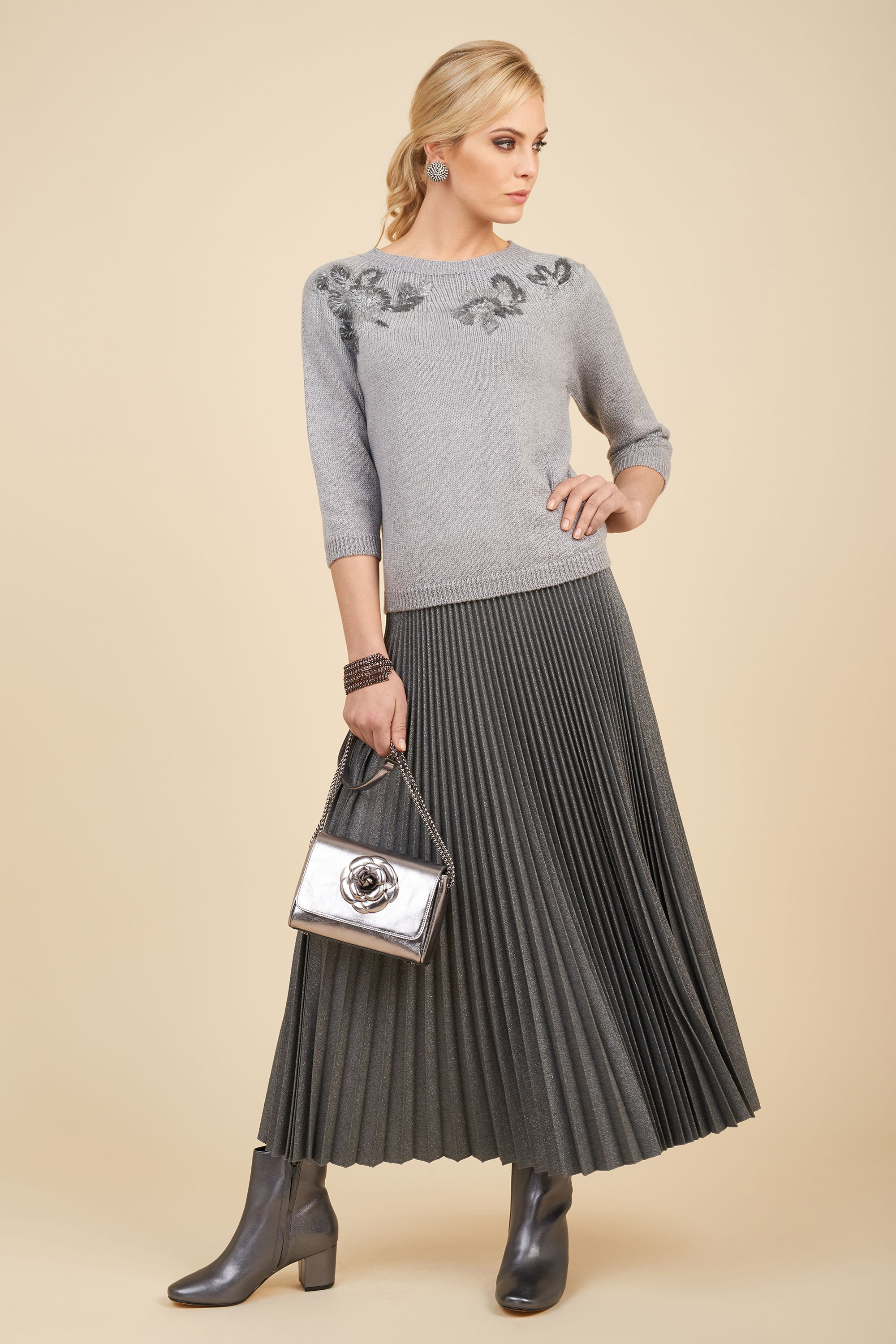 Woollen lurex blend pullover with hand embroidered rhinestones and long wool blend and lurex skirt,