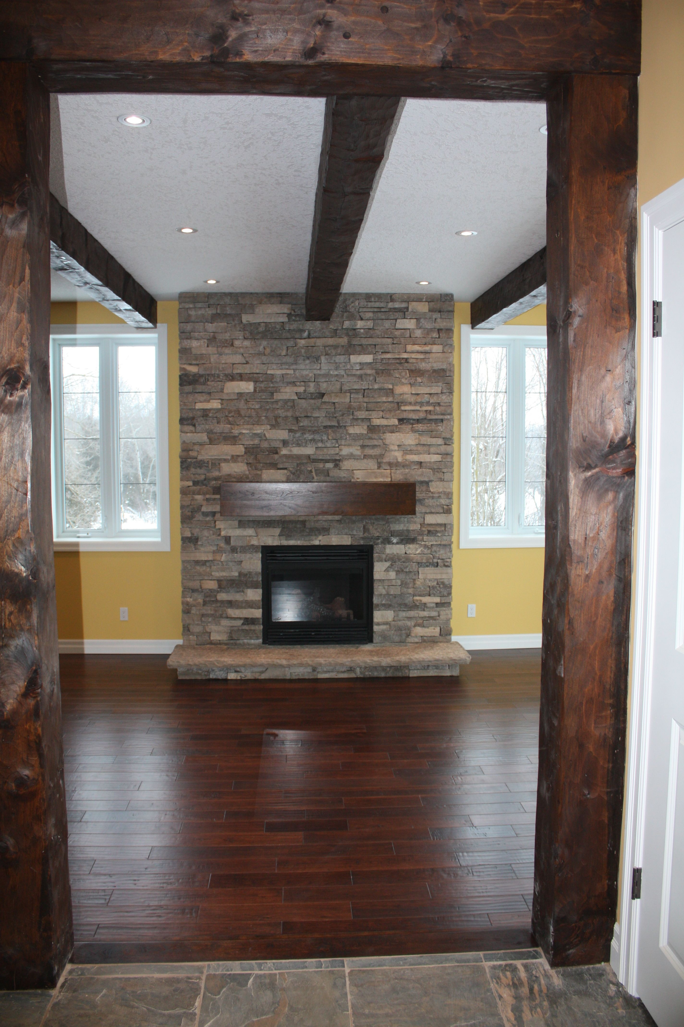 stone mantel fireplace floor to ceiling ledgerock with timber