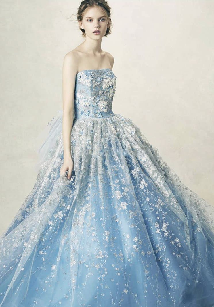 A romantic pastel blue ball gown from Anteprima featuring lavish ...