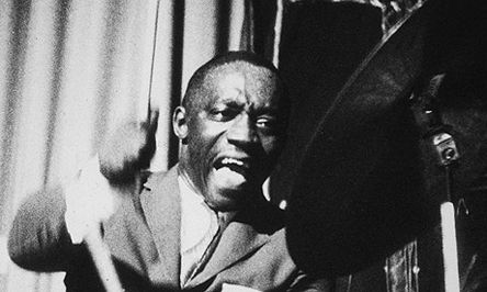 """Art Blakey. His style of bebop was so aggressive that the term """"hard bop"""" was coined to describe the music that Art Blakey and the Jazz Messengers played from the 1950s through the late '80s. Blakey came to major prominence in the late '40s as a member of Billy Eckstine's band, which featured Miles Davis, Dexter Gordon and Fats Navarro."""