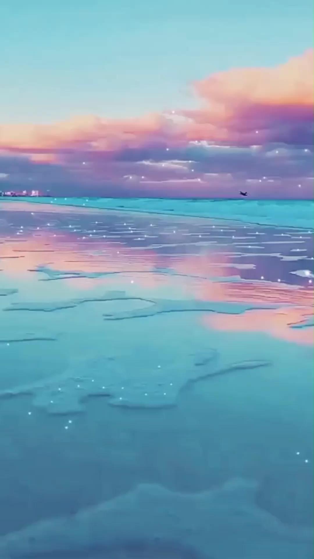 Hình nền động bãi biển đầy sắc màu