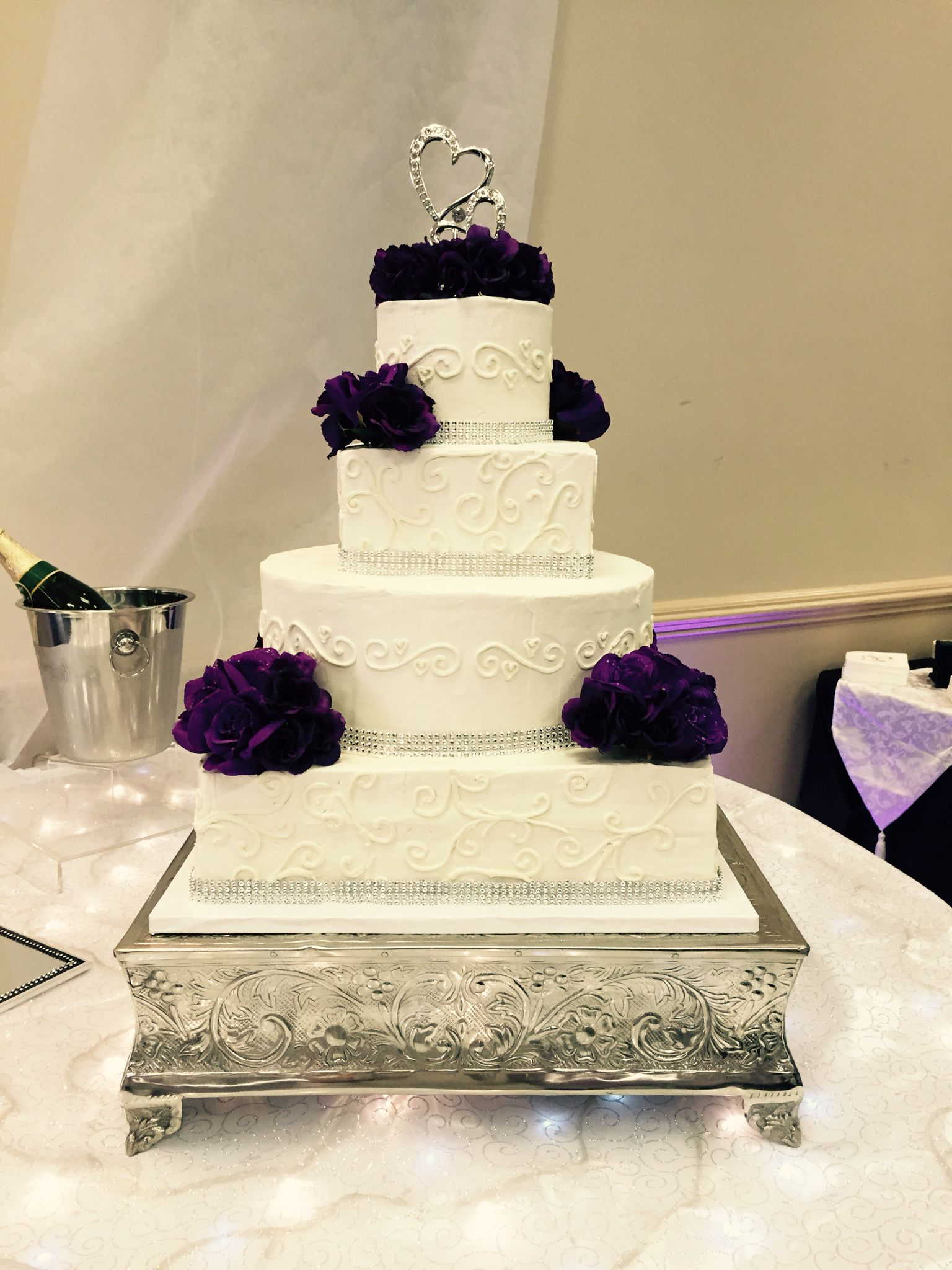 buttercream with scroll piping & bling ribbon