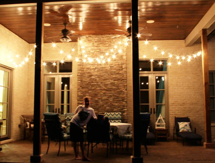 The back porch, the night of the surprise...before the fall flowers were added.Bear popped in the pic, reminding me that he also helped with the secret light surprise. He still reminds me every other day.